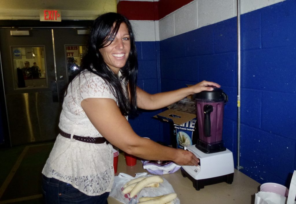 Making HIgh Carbohydrate Smoothies for the Athletes during hockey camp.