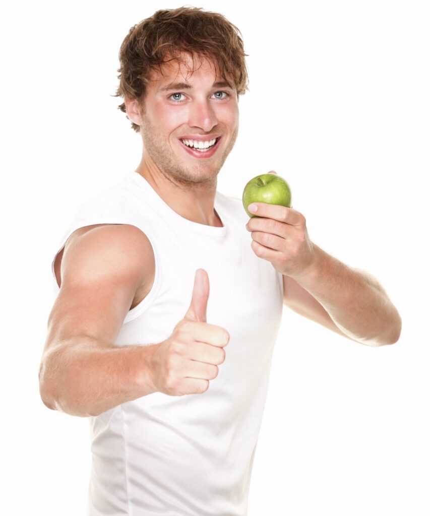 Man eating an Apple - POst on Performance Fueling- What and When to eat Before exercise