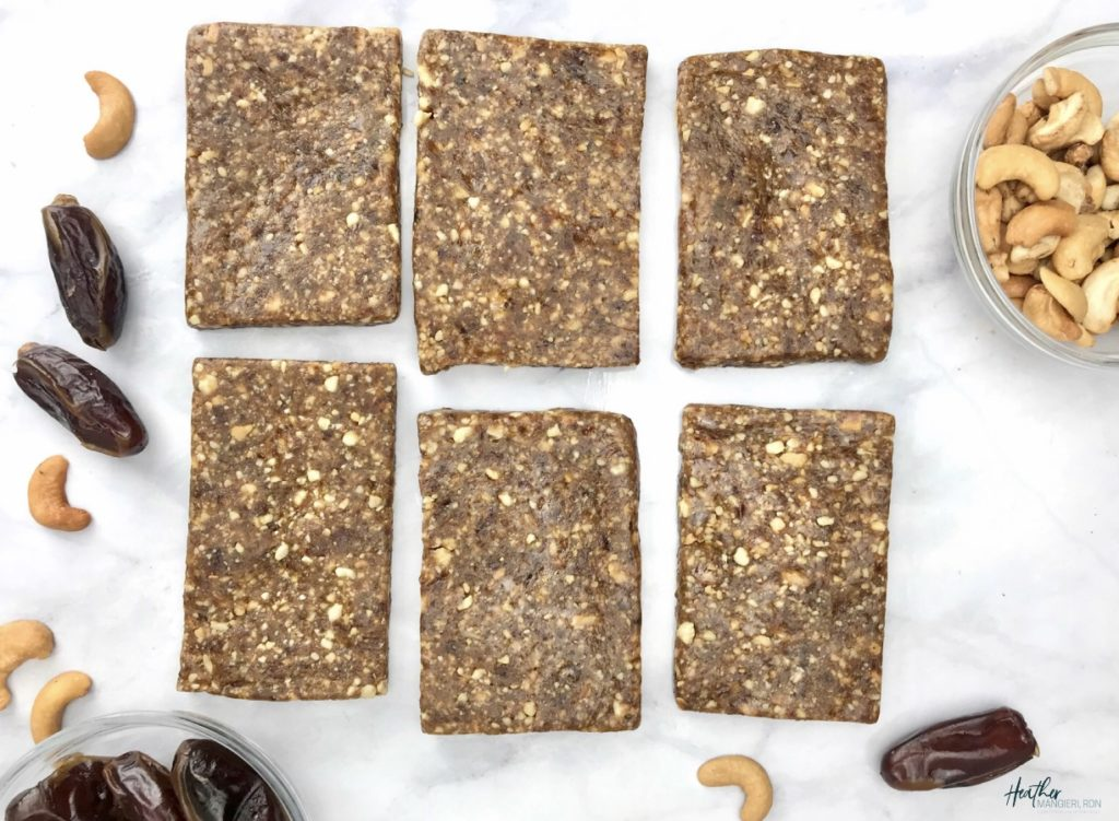 These homemade fruit and nut bars were inspired by my love for the cashew-cookie flavored LaraBar. They are the perfect snack to take with you on a hike or bike ride or to satisfy a mid-day sweet tooth