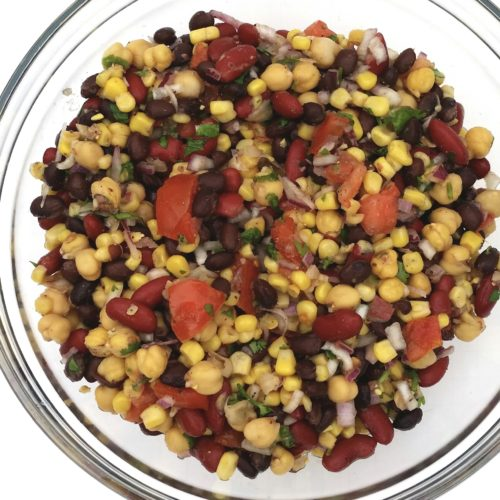 This low sugar protein-packed three bean salad is a twist on traditional recipes, resulting in more high-quality protein and fiber per serving, while having less sugar and fat. It makes a great side dish at home or on the go.