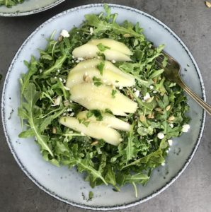 This pear and arugula salad with a reduced-fat lime cilantro vinaigrette is 300 calories, 9 grams of protein, 21 grams of fat and 6 grams of fiber. The combination of sweet, savory and salty flavors make it a delicious lunch or cut the serving size in half for a side salad to serve with dinner