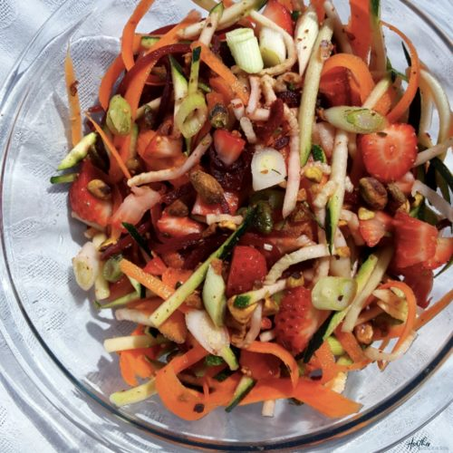 This rainbow vegetable slaw salad incorporates carrots, beets, zucchini and strawberries for a flavorful and nutrition packed salad, perfect for your next party or picnic