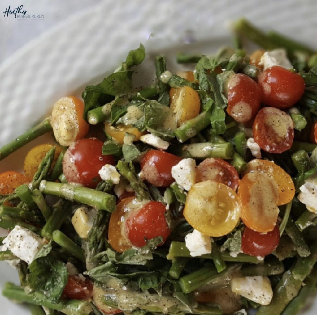 This colorful and refreshing tri-colored tomato and asparagus salad is loaded with fiber, phytonutrients, vitamins and minerals and makes a perfect party or picnic salad.