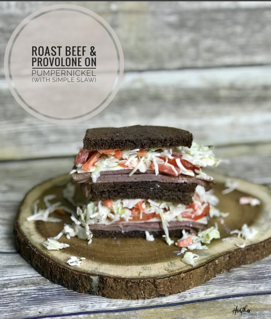 This roast beef and provolone on toasted pumpernickel is topped with simple slaw and tomatoes, adding loads of flavor to an otherwise simple sandwich.
