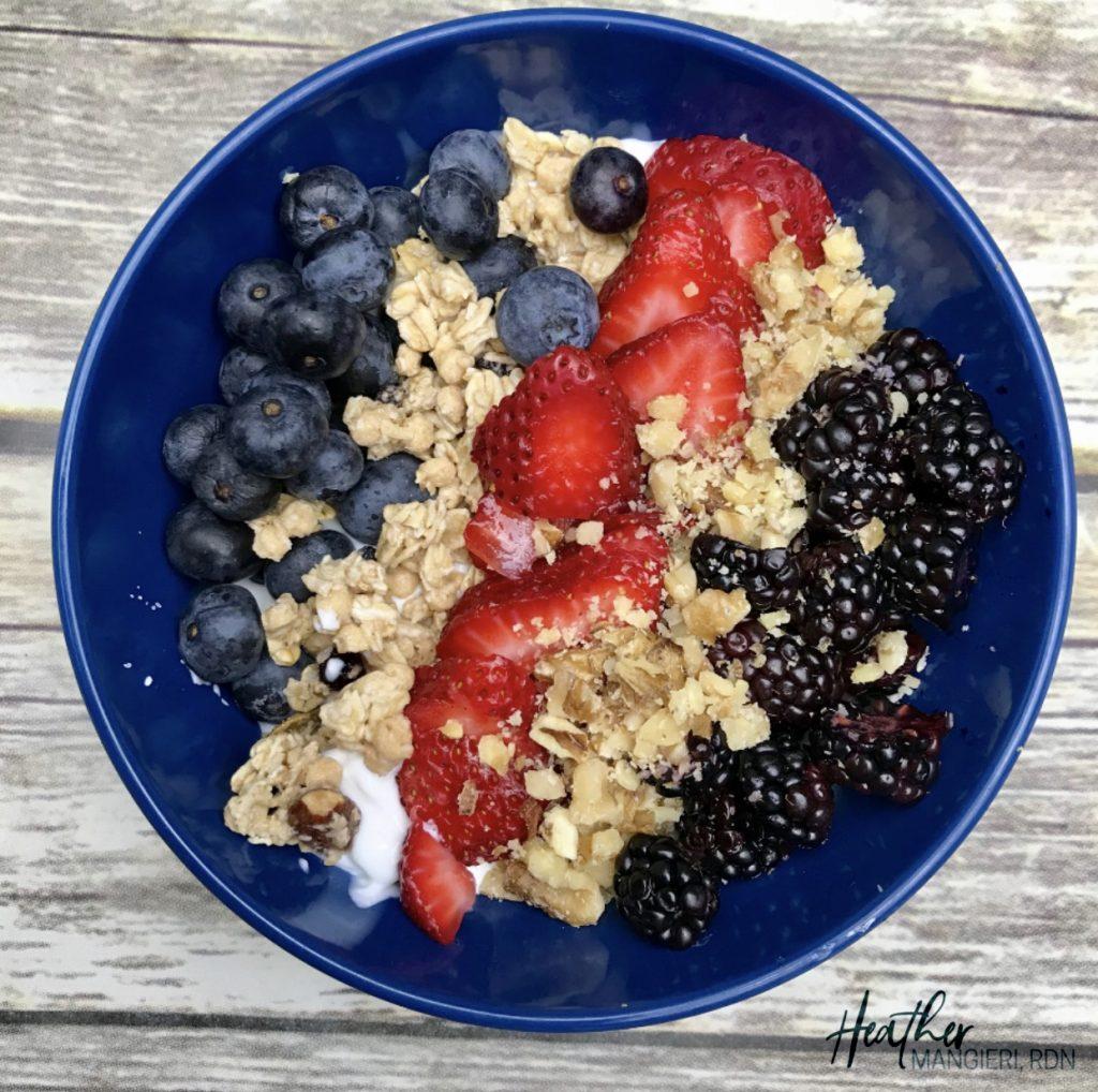 Plain Greek Yogurt Topped with Strawberries, Blackberries, Blueberries, Crushed Walnuts and Granola