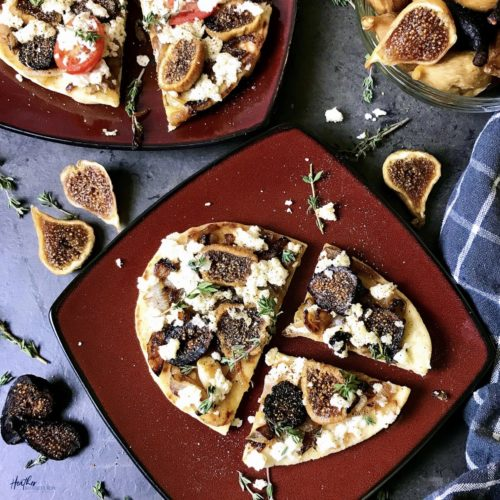 This flatbread pizza pairs dried figs and caramelized onions with creamy ricotta cheese for a delicious sweet and savory meal. Perfect to serve as a Thanksgiving day appetizer.