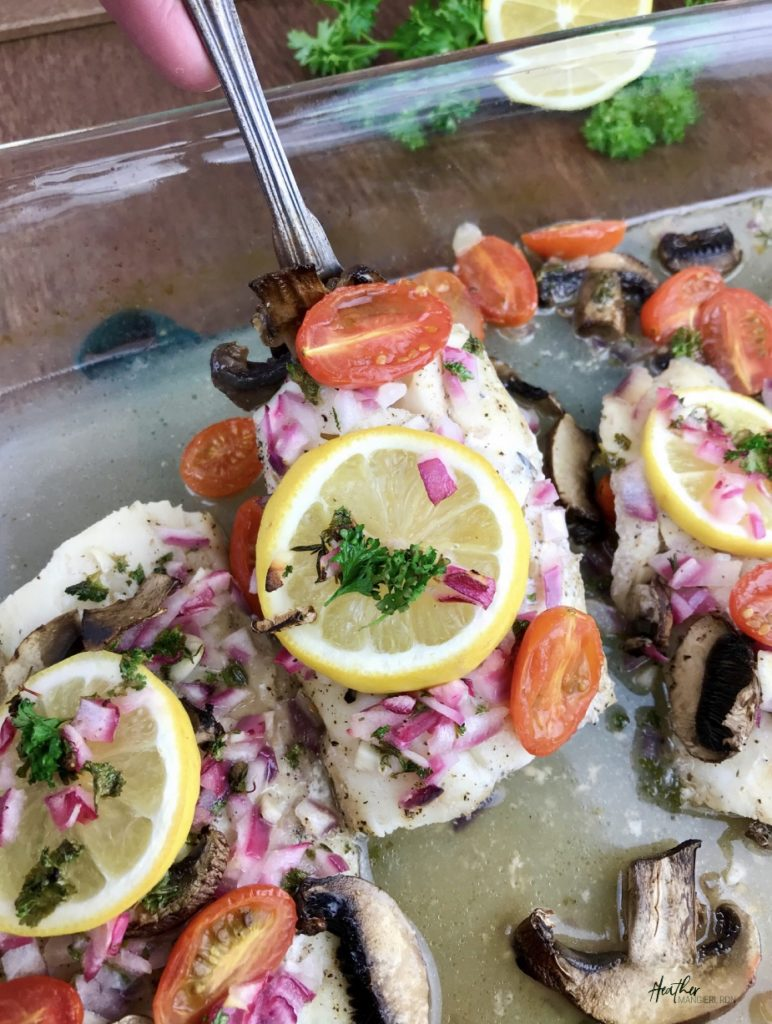 This post discusses the flavor of cod and share what it is, the calories, fat and other nutrition information of cod, and how to make a delicious lemon baked cod with mushrooms and tomatoes recipe for a quick dinner.