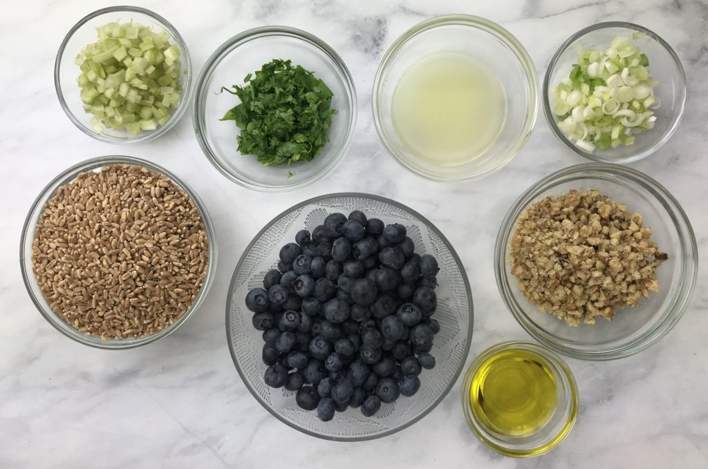 These are the ingredients needed to make a simple wheat berry and blueberry salad. It's is a blend of plump blueberries, whole grain wheat berries and other flavorful ingredients all combined into one delicious chilled salad.