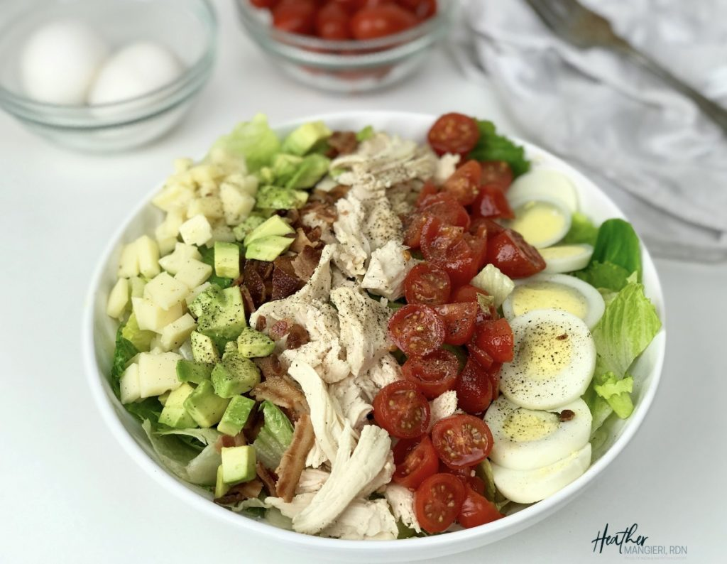 This modified classic cobb salad is packed with protein and nutrients, and portioned with ingredients to make a healthy quick and easy  meal.