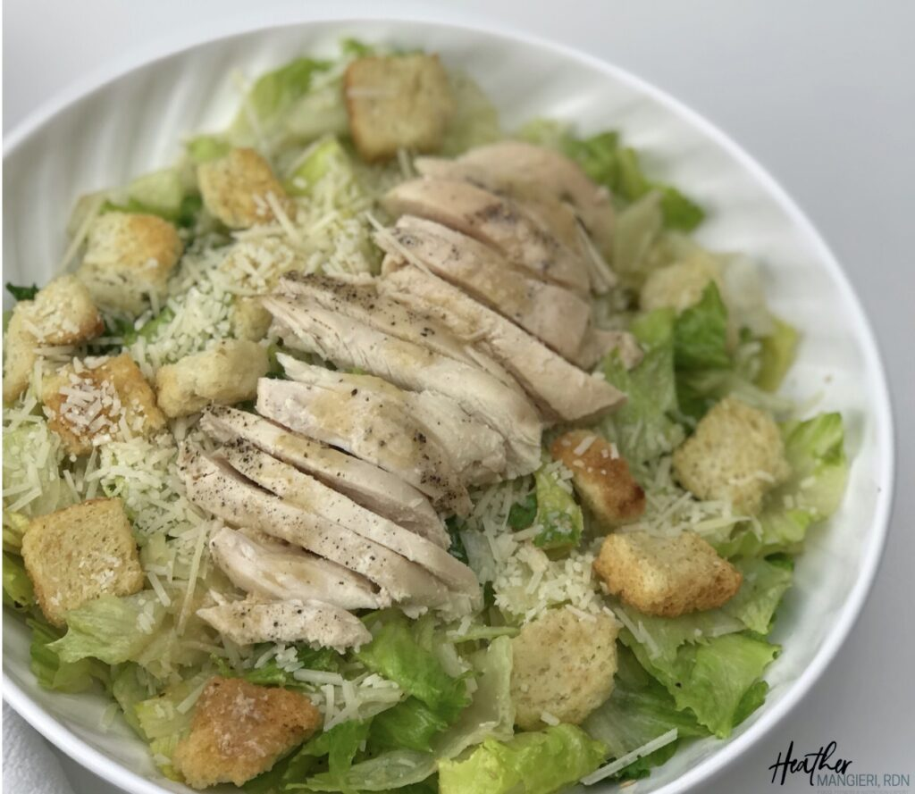 Learn how many calories and fat are in a Caesar salad and how to make a healthier version