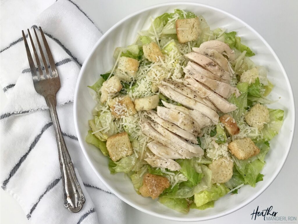 A healthier grilled chicken Caesar salad with 340 calories, 15 grams of fat and portion controlled to provide a healthy, balanced meal