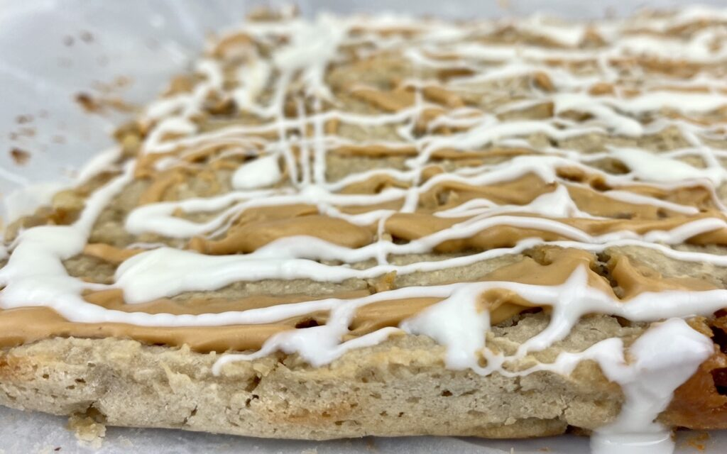White Bean Blondie Bars Cooked with Chocolate Drizzle (close-up)
