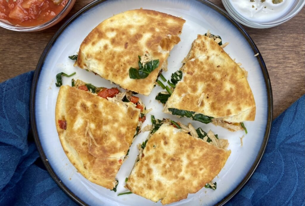 This crispy, flavor-filled chicken and spinach quesadilla is packed with nutrition and takes under 10 minutes to make! It's a delicious and easy way to get more greens, protein, fiber, calcium and iron in your diet!