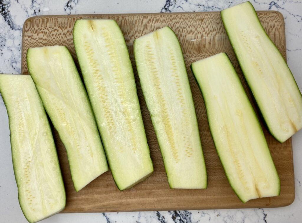 zucchini sliced lengthwise to make roasted zucchini strips